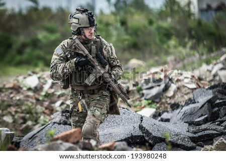 soldier on patrol at modern battle field - stock photo
