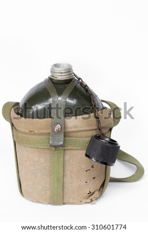 Soldier open flask (canteen) in decay cloth winding - stock photo