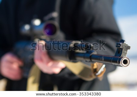 soldier or sniper holding gun with virtual screen projection and aiming in forest - stock photo