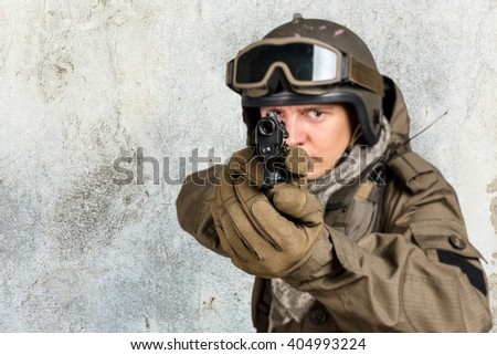 Soldier pointing gun at you