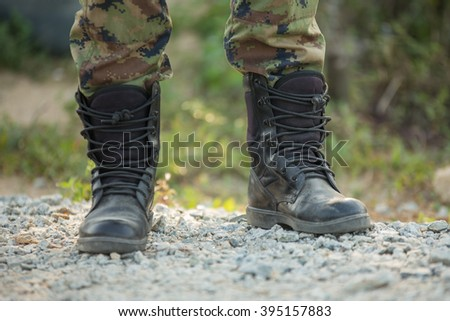 Soldier protecting shoes