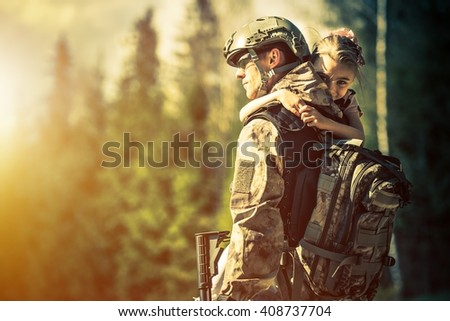 Soldier Returning Home After Years of War. Happy Daughter Welcoming Her Dad at Home. Troop Returning Concept. - stock photo