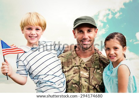 Soldier reunited with his children against blue sky - stock photo