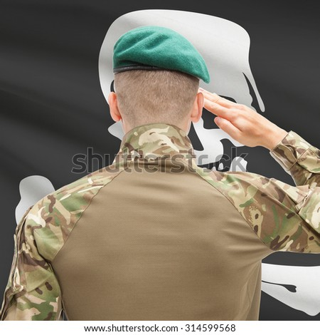 Soldier saluting to US state flag series - Jolly Roger - stock photo
