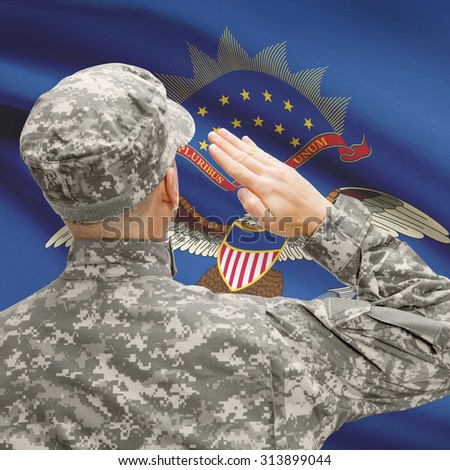 Soldier saluting to USA state flag conceptual series - North Dakota