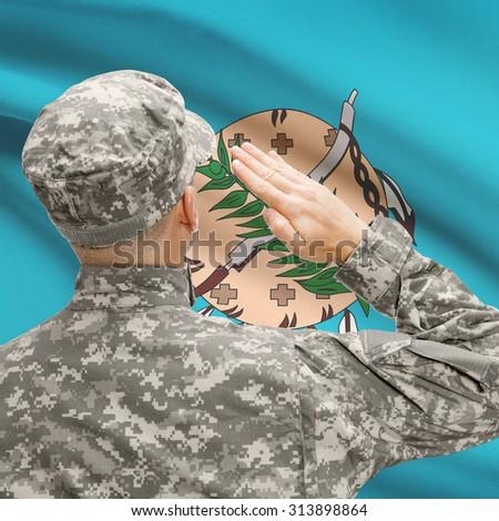 Soldier saluting to USA state flag conceptual series - Oklahoma - stock photo