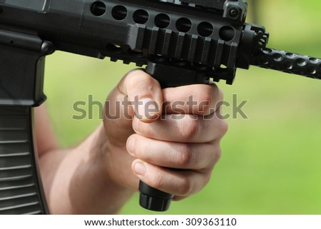 soldier shoot at a target with automatic weapon - stock photo