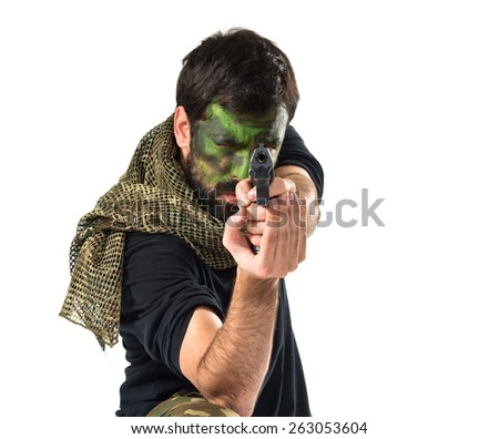 Soldier shooting with a pistol  - stock photo