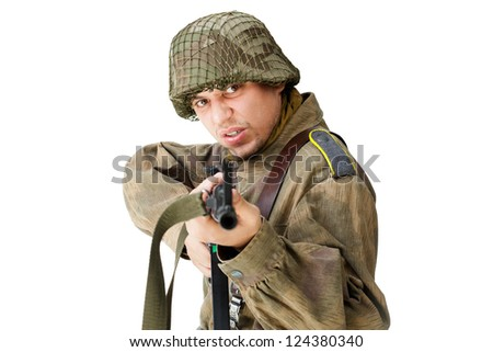 Soldier shoots submachine gun isolated on white background - stock photo