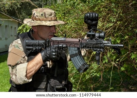 soldier special counterterrorism unit, sa.vz.58 with an assault rifle, caliber 7.62 mm - stock photo