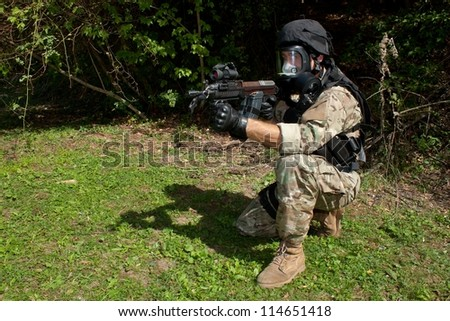 soldier special counterterrorism unit, sa.vz.58 with an assault rifle, caliber 7.62 mm, in a gas mask - stock photo