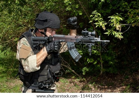 soldier special counterterrorism unit, sa.vz.58 with an assault rifle, caliber 7.62 mm, shows STOP signal - stock photo
