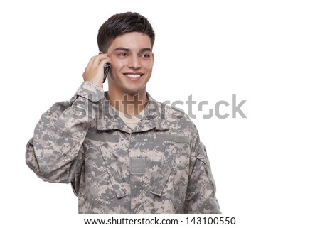 Soldier talking over cell phone  - stock photo