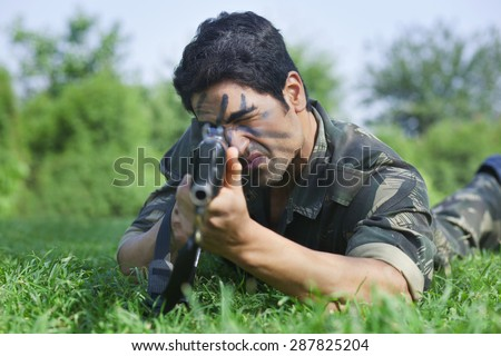 Soldier targeting with rifle - stock photo