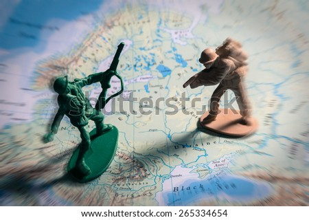 Soldier toys on map,war concept.. - stock photo