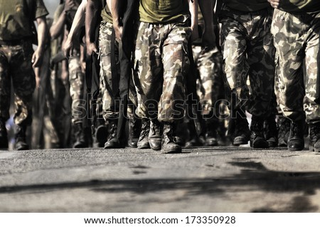 soldier walking towards camera - stock photo