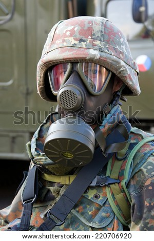 Soldier wearing a gas mask - stock photo