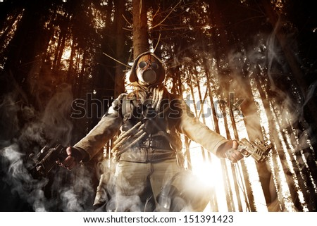 Soldier wearing a gas mask in a forest