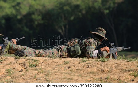soldier who prepared for shooting rifle - stock photo