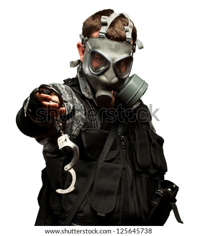 Soldier With  A Gas Mask Holding Handcuffs On White Background - stock photo