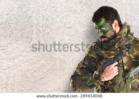 Soldier with a gun - stock photo