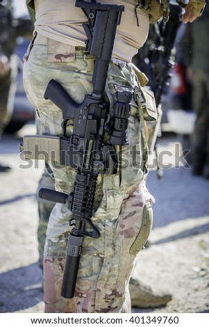 Soldier with a loaded M4 assault Close up
