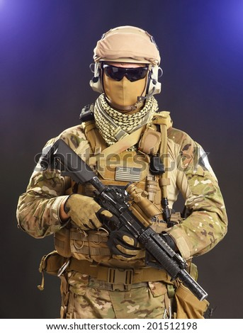 soldier with a rifle isolated on black background