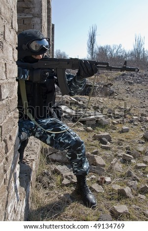 Soldier with an automatic rifle AK-47 targeting - stock photo
