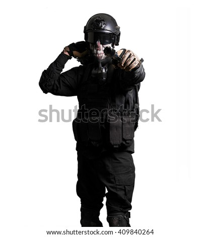 Soldier with double deserte eagle pointing isolated - stock photo