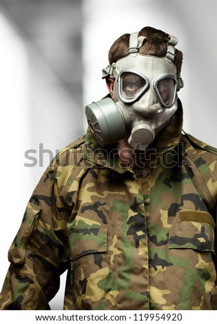 Soldier With Gas Mask against an abstract background - stock photo