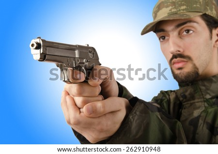Soldier with gun isolated on white - stock photo