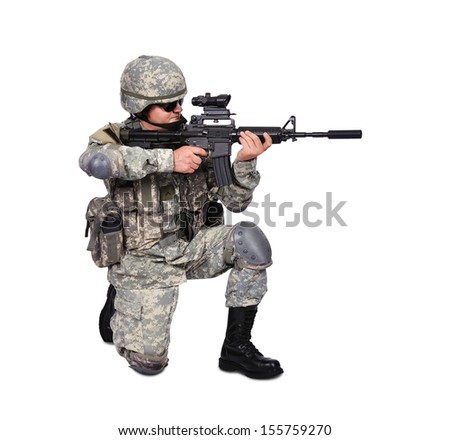 soldier with his assault rifle on white background - stock photo