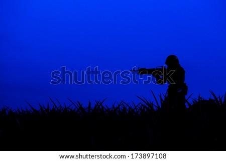 soldier with machine gun - stock photo
