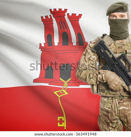 Soldier with machine gun and national flag on background series - Gibraltar - stock photo
