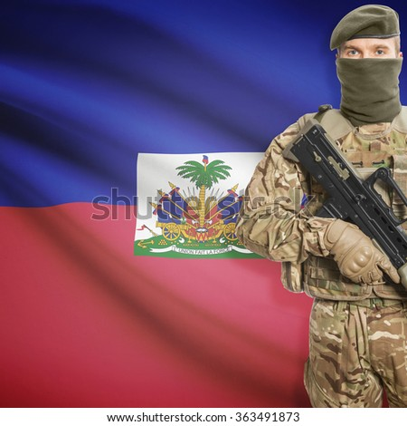 Soldier with machine gun and national flag on background series - Haiti