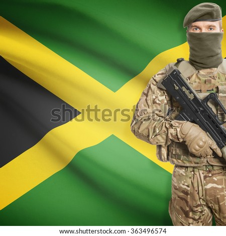 Soldier with machine gun and national flag on background series - Jamaica - stock photo