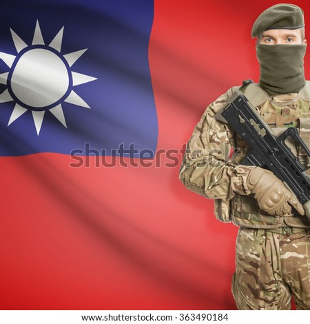 Soldier with machine gun and national flag on background series - Taiwan - stock photo