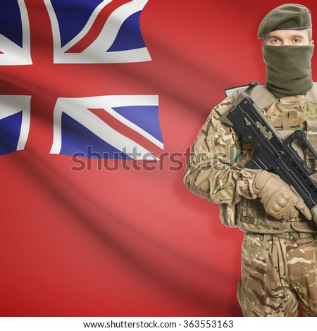 Soldier with machine-gun in hands and Canadian province flag on background series - Manitoba