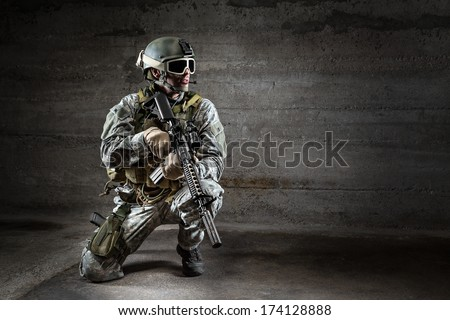 Soldier with mask rifle and backpack - stock photo