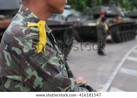 Soldier with military tank background.