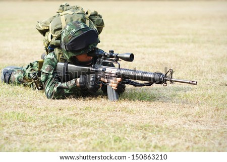 Soldier with rifle - stock photo