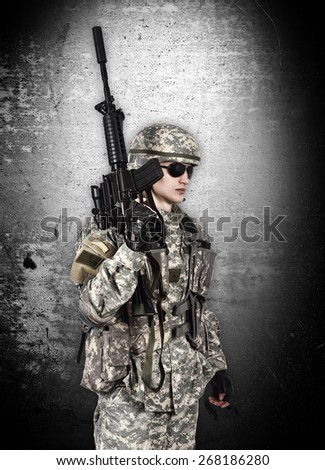 soldier with rifle isolation on gray background - stock photo
