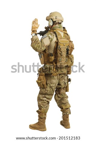 Soldier with rifle on a white background