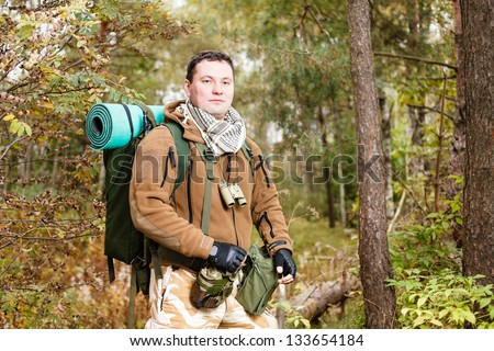 Soldier with rucksack in a forest. - stock photo
