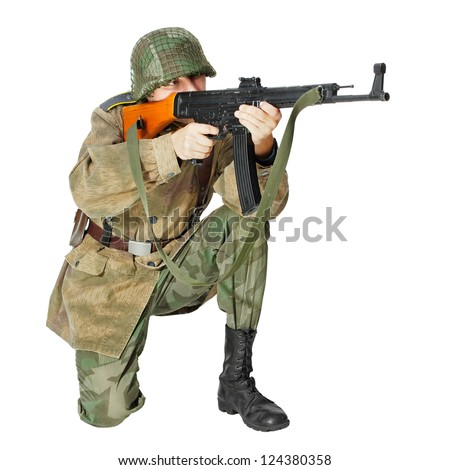 Soldier with submachine gun, second world war style. Isolated on white background - stock photo