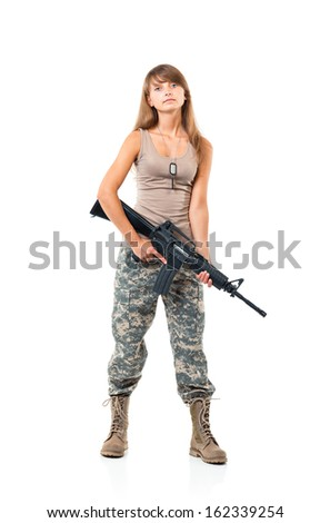 Soldier young beautiful girl dressed in a camouflage with a gun in his hand on white background