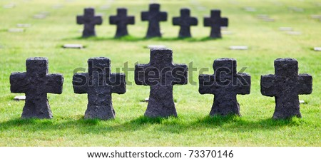 Soldiers Crosses at German Military Cemetery and Memorial in La Cambe, Normandy, France. Over 11.000 German fallen soldiers of World War 2 are buried here. - stock photo