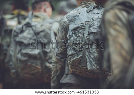 Soldiers , guarded , military equipment , military combat .