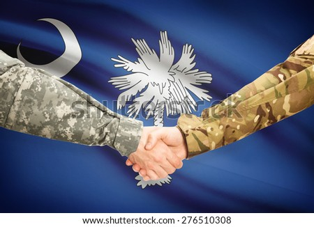 Soldiers handshake and US state flag - South Carolina - stock photo