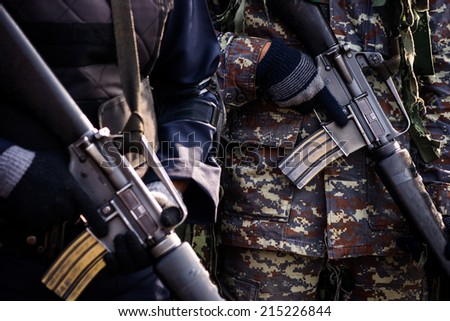 Soldiers Holding a Machine Gun - stock photo